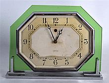 A STYLISH RETRO SMITH GREEN GLASS AND CHROME MANTEL CLOCK with octagonal di