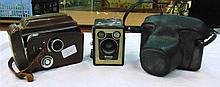 A GROUP OF THREE VINTAGE CAMERA'S, including a Brownie. (3)