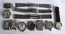 A COLLECTION OF VINTAGE WATCH FACES AND DIALS together with various straps