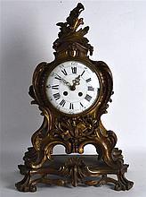 A 19TH CERNTURY FRENCH BRONZE ROCOCO MANTEL CLOCK with foliate terminal and