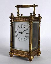 AN EARLY 20TH CENTURY FRENCH BRASS CARRIAGE CLOCK with white enamel dial an