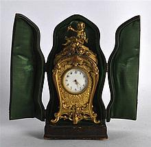A LOVELY CASED LATE 19TH CENTURY FRENCH BRONZE TRAVELLING CLOCK of scrollin