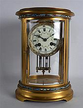 AN EARLY 20TH CENTURY FRENCH BRONZE AND CHAMPLEVE ENAMEL OVAL REGULATOR MAN