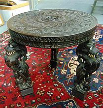 AN ANTIQUE CARVED ANGLO INDIAN TABLE, the top carved with mythical figure .
