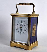 A FRENCH BRASS CASED CARRIAGE CLOCK set with Limoges porcelain panels, deco