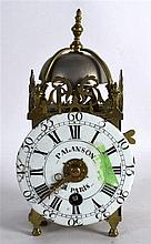 AN EARLY FRENCH BRASS LANTERN CLOCK with white enamel dial signed Palanson