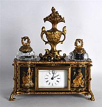 A LATE 19TH CENTURY FRENCH BLACK LACQUER AND GILT METAL MANTEL CLOCK with t