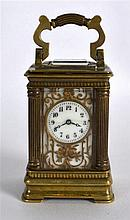 AN EARLY 20TH CENTURY FRENCH MINIATURE CARRIAGE CLOCK with white enamel dia