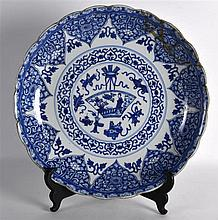A LARGE 17TH CENTURY CHINESE BLUE AND WHITE SCALLOPED CHARGER Kangxi, paint