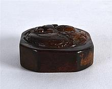 A CHINESE QING DYNASTY CARVED MUTTON JADE SEAL of square form, carved with