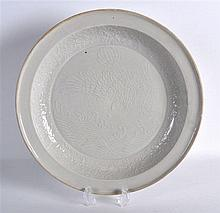 A CHINESE QING DYNASTY WHITE GLAZED CIRCULAR DISH decorated with a hawk abo