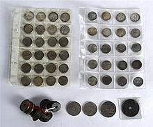 A COLLECTION OF VARIOUS CHINESE COINS in various forms. (13)