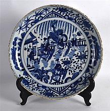 AN 18TH CENTURY CHINESE BLUE AND WHITE PORCELAIN DISH painted with figures