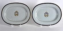 A PAIR OF 18TH CENTURY CHINESE EXPORT ARMORIAL DISHES painted under a blue