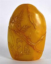 A CHINESE CARVED TIANHUANG TYPE YELLOW HARDSTONE SEAL decorated with figure