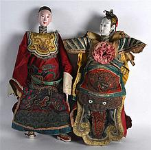 A PAIR OF EARLY 20TH CENTURY CHINESE SILKWORK DOLLS each modelled in elabor