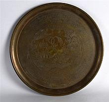 AN EARLY 20TH CENTURY CHINESE ENGRAVED BRASS CHARGER decorated with figures