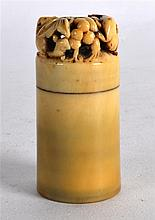 A GOOD 18TH CENTURY CHINESE CARVED IVORY SEAL of cylindrical form, the fini