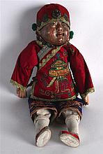 AN EARLY 20TH CENTURY MONGOLIAN FIGURE OF A DOLL modelled in silk robes, em