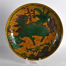 AN EARLY 20TH CENTURY CHINESE SANCAI GLAZED CIRCULAR DISH decorated with a