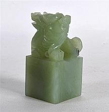 AN EARLY 20TH CENTURY CHINESE CARVED GREEN JADE SEAL in the form of a beast