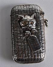 A NOVELTY SILVER CAT IN BASKET VESTA CASE.