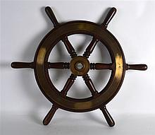 AN EARLY 20TH CENTURY CARVED WOOD BRASS BOUND SHIP