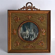 A 19TH CENTURY FRENCH GILT METAL EMPIRE PHOTOGRAPH