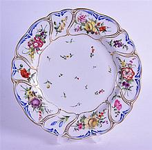 A 19TH CENTURY DERBY PLATE, of Trotter type, painted with flowers in the manner of Keys. 25 cm diameter.