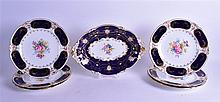 ROYAL CROWN DERBY SET OF SIX PLATES PAINTED WITH FLOWERS, together with a similar footed dish. (7)