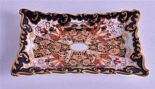 A ROYAL CROWN DERBY PIN TRAY, painted in imari pattern. 12 cm wide.