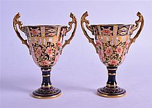 A PAIR OF ROYAL CROWN DERBY TROPHY SHAPED VASES , painted in imari pattern. 9.5 cm wide.