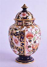 A ROYAL CROWN DERBY VASE & COVER, painted in imari pattern. 8.5 cm high.
