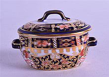 A ROYAL CROWN DERBY MINIATURE CASSEROLE, painted in imari pattern. 8 cm wide.