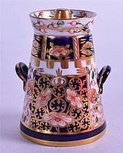 A ROYAL CROWN DERBY MINIATURE MILK CHURN & COVER, painted in imari pattern. 7 cm high.