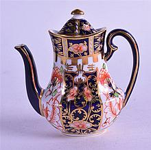 A ROYAL CROWN DERBY MINIATURE COFFEE POT & COVER, painted in imari pattern. 9.5 cm wide.