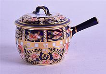 A ROYAL CROWN DERBY MINIATURE SAUCEPAN & COVER, painted in imari pattern. 9.5 cm wide.