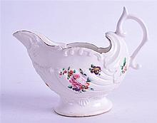 AN 18TH CENTURY CHELSEA DERBY DOLPHIN EWER, painted with flowers in the manner of Edward Withers. 15.5 cm wide.