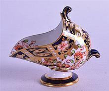 A ROYAL CROWN DERBY MINIATURE COAL SCUTTLE, painted in imari pattern. 8 cm wide.