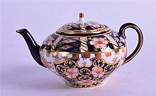 A ROYAL CROWN DERBY MINIATURE TEAPOT, painted in imari pattern. 9.5 cm wide.