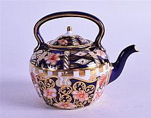 A ROYAL CROWN DERBY MINIATURE KETTLE, painted in imari patten. 7 cm high.