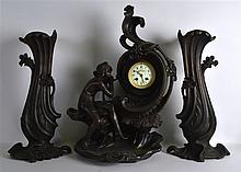 A LARGE ART NOUVEAU COLD PAINTED SPELTER CLOCK GAR