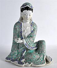 AN EARLY 20TH CENTURY CHINESE FAMILLE ROSE FIGURE