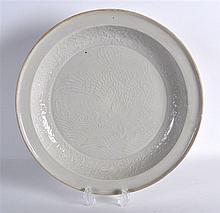 A CHINESE QING DYNASTY WHITE GLAZED CIRCULAR DISH
