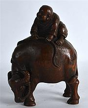 A CHINESE CARVED BAMBOO FIGURE OF A BOY ON BUFFALO