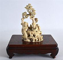 A LATE 19TH CENTURY CHINESE CARVED IVORY FIGURAL G