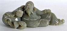 A CHINESE CARVED GREEN JADE FIGURE OF A RECUMBANT