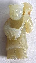 A CHINESE CARVED GREEN JADE FIGURE OF A YOUNG BOY