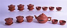 A CHINESE YIXING POTTERY TEASET comprising off teapot, teabowls, saucers etc. (qty)