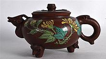 AN UNUSUAL CHINESE ENAMELLED YIXING POTTERY TEAPOT AND COVER painted with flowers. Signed. 6.5ins wide.